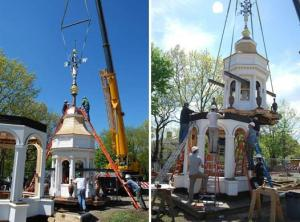 Here is the rebuilt lantern  as it is lifted from the ground to be put in place.