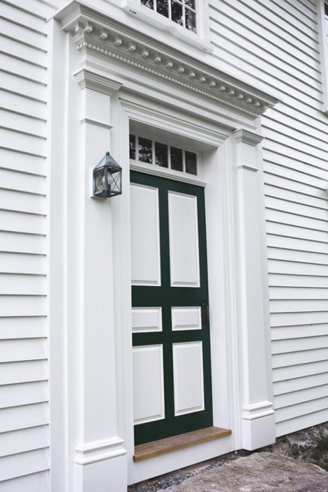 New front door entry. The intended result was an earnest, good faith recreation of the missing architectural details, not a counterfeit of original historic work.