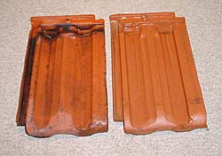 "BEWARE THE LUDOWICI TWINS. THEY LOOK ALIKE BUT DON'T WORK WELL TOGETHER. (caption, photo courtesy Roof Slate and Tile Company) Apparently identical, these two pieces of Clay Red French Profile tile were made in different plants owned by Ludowici Celadon in the 1940's, New Lexington, Ohio and Coffeyville, Kansas, respectively. Careful examination of this photograph will reveal numerous differences in the width of channels and ribs sufficient to prevent the installation of any volume of one into the other. Individual tiles may be made to fit, but larger patches will ""creep"" considerably. Additionally, the Ohio tile is noticeably redder, the clay that produced it having originated from a different clay bed. Diligent confirmation of the compatibility of replacement tile can help to assure the success of your project."