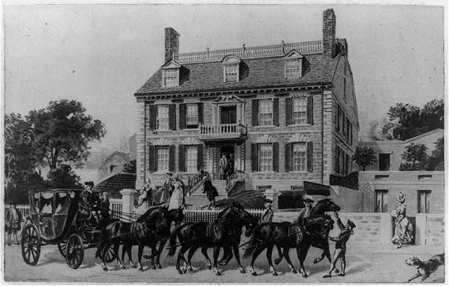 1893 photo of earlier (date?) drawing of Gov. Hancock's house with a coach and six in front. Not our carriage, we can see, but if you look close, you can maybe see the coat of arms.