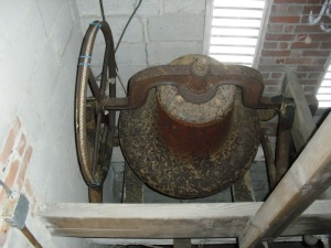 Bell sits in unstable cast iron standards.
