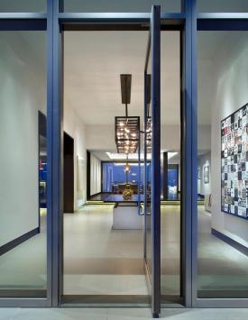 Pivot door, anodized aluminum finish.