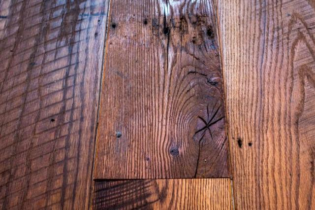 Note saw marks and nail holes. The hand sanding and finishing doesn't show, nor is it meant to. It is intended to bring out, not to conceal, the imperfections.