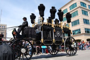 Reproduction hearse re-enacts the Lincoln funeral procession.