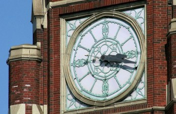 Tower clock face exterior view.