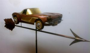 A 1960 Corvette, modelled in hand formed copper, with 23 carat gold accents.