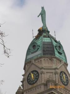 Rigger begins to assemble scaffolding at the base of the statue, 150 feet in the air.