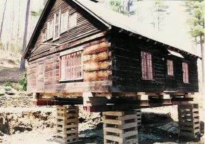 Historic 1760 Vermont hand hewn log cabin on cribbing, ready for the foundation install.