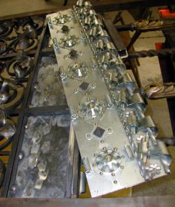 Detail of the interior gate, before full assembly, showing the richness of this Renaissance style installation, in multiple metals.