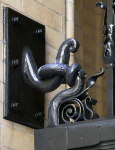 A hand forged detail, showing the gate hanger and attachment to the masonry.