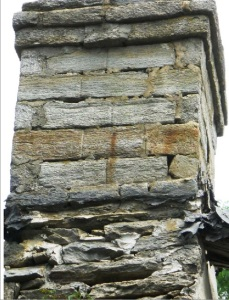 Coursed and dressed stone at chimney crown.