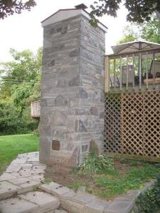 "Backside of the oven ""tower"", built up to serve a second level deck."