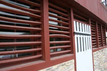 Restored louvres and doors gives the barn period authority.
