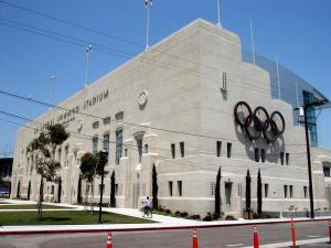 The 32 Olympic Swim Stadium, clad in period board formed concrete.