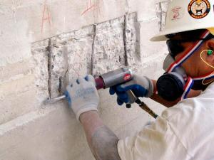 Carefully removing damaged concrete to sound material, and restoring the structural steel.