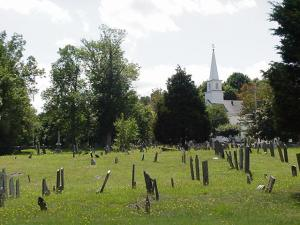 The burial ground, Plympton center, in a district listed in the National Register of Historic Places.