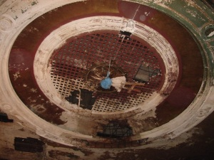 Tighter view ceiling original dome, note blue sheeting over pendant plaster mold.