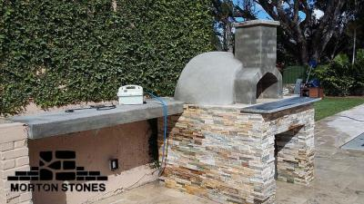 Handsome pizza oven complete assembly, including veneered base and work counter.
