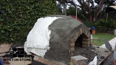 "Stucco final finish going on over masonry ""blanket""."