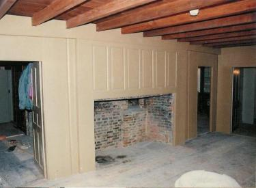 Showing original fireplace, replicated panelling.