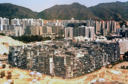 Kowloon Walled City in the foreground, Hong Kong behind.