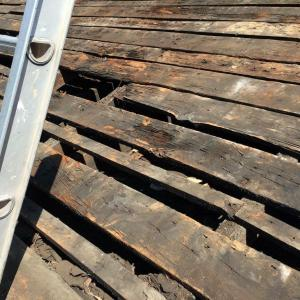 "Typical condition of original ""skip"" decking, sound enough when resecured and covered with plywood."